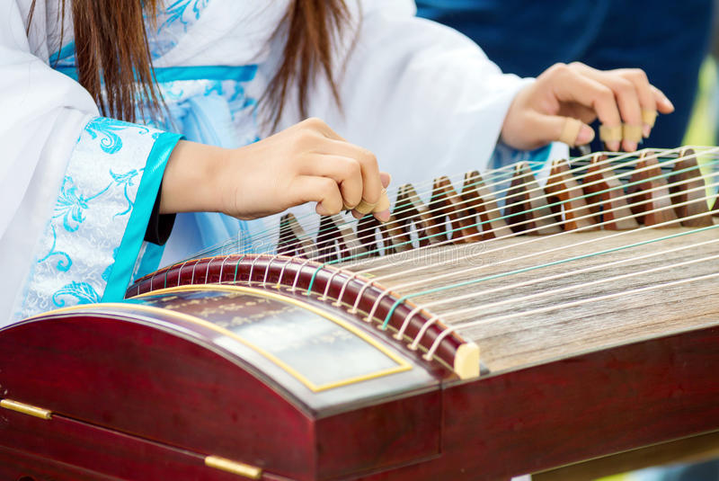 Girl playing classical Chinese instruments stock photo