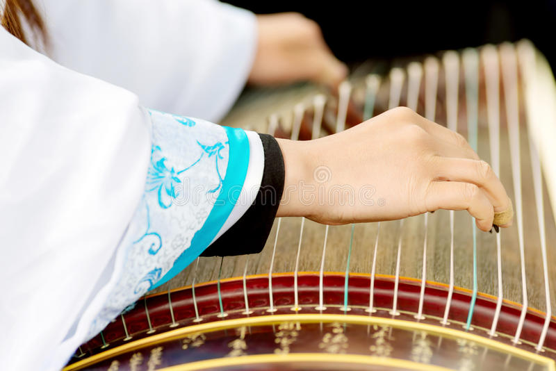 Girl playing classical Chinese instruments stock photography