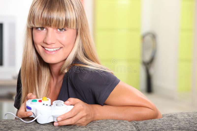 Girl Playing With Console Royalty Free Stock Images