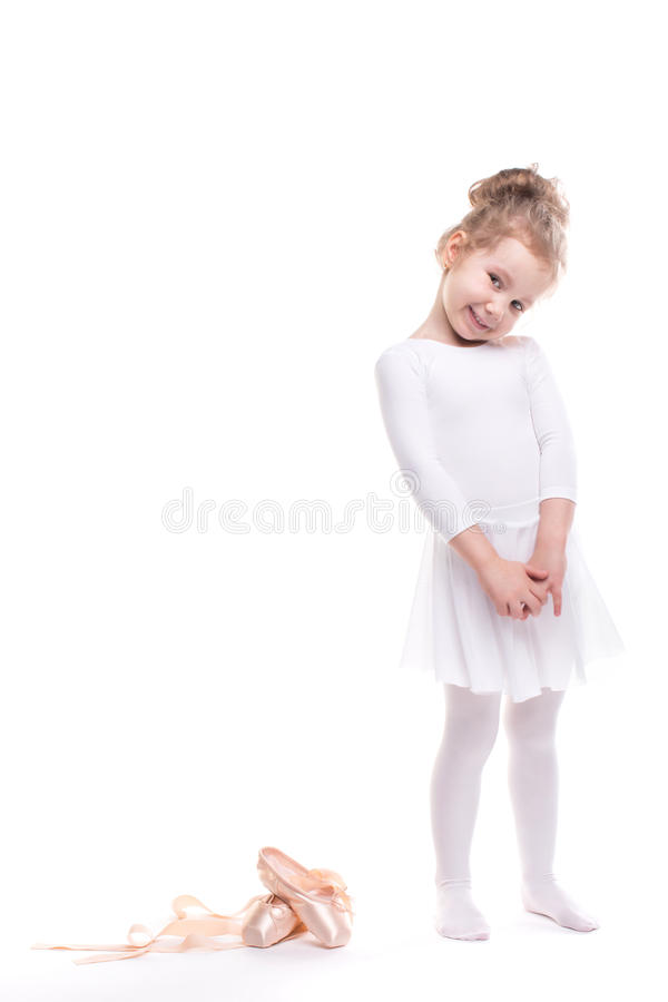Girl playing. Cute child dancing classical ballet in white studio. stock photography