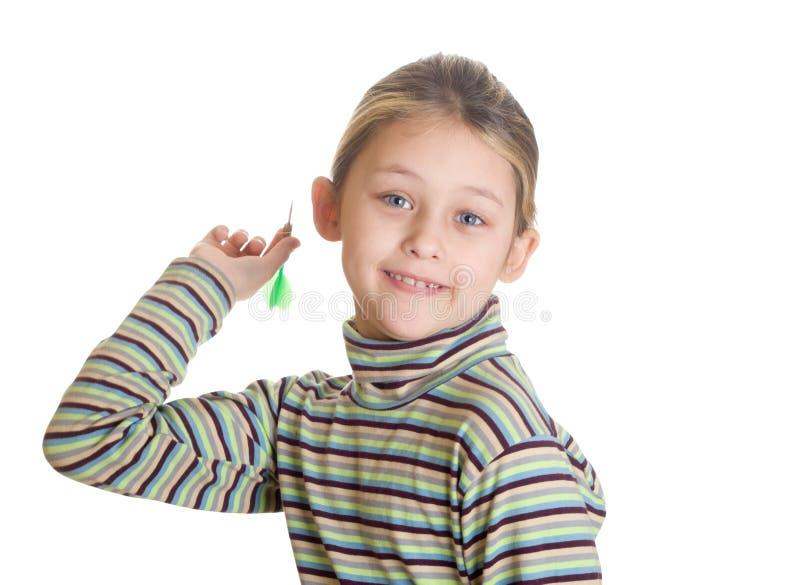 Girl playing darts. Isolated on white background royalty free stock photo