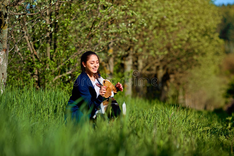 Girl playing with a dog in the park. royalty free stock image