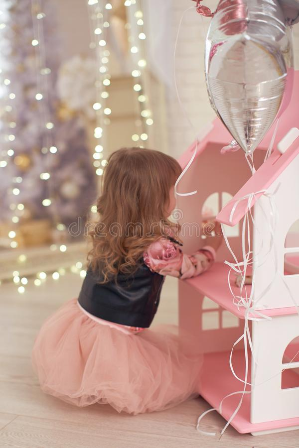 Girl playing in a doll house royalty free stock image
