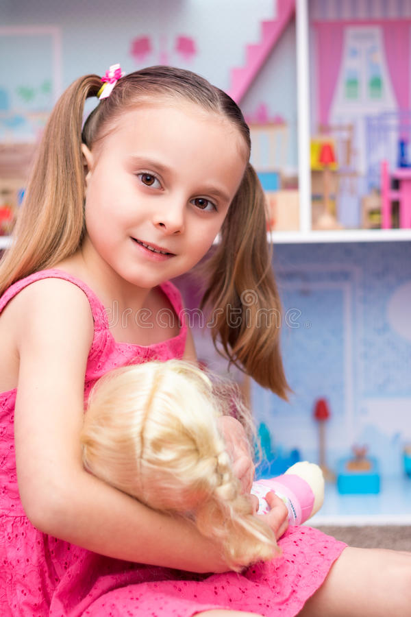 Girl Playing Dolls royalty free stock photos