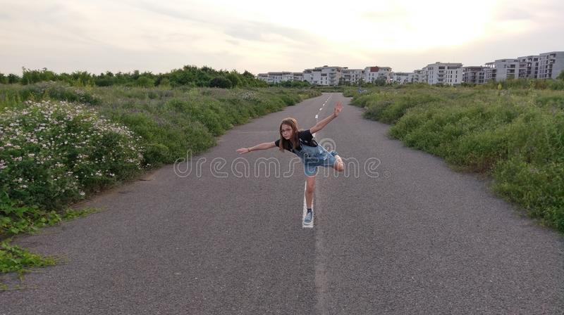 Girl playing on empty street royalty free stock photography
