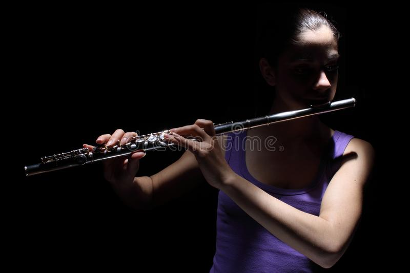 Girl playing a flute royalty free stock images