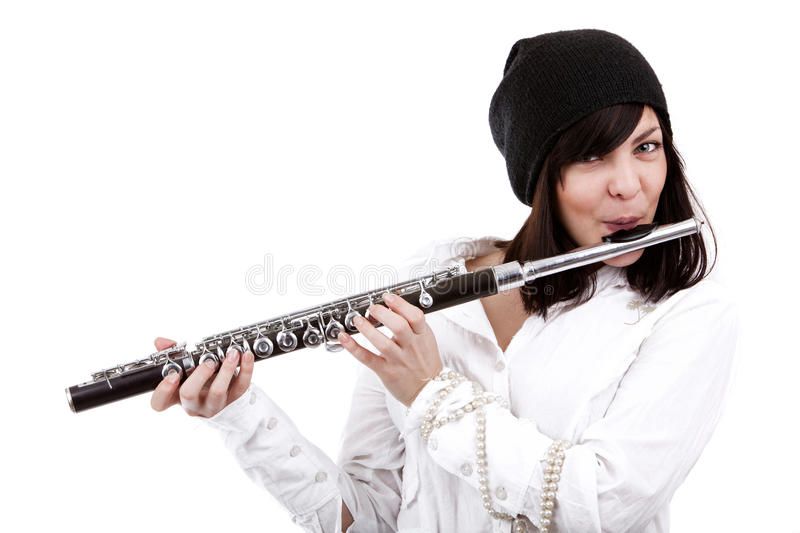 Girl playing on flute stock images