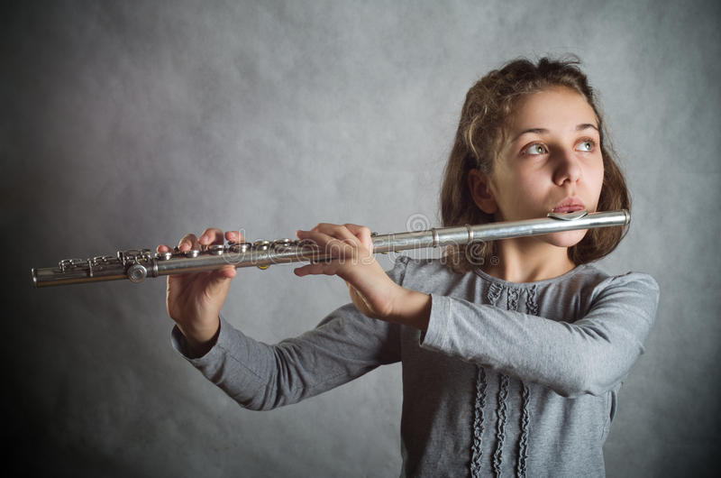 Girl Playing Flute royalty free stock photo