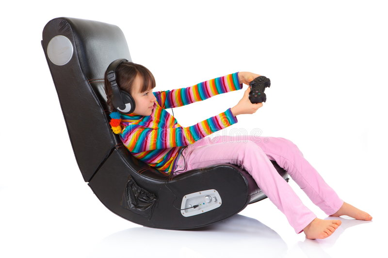 Girl playing game in chair royalty free stock images