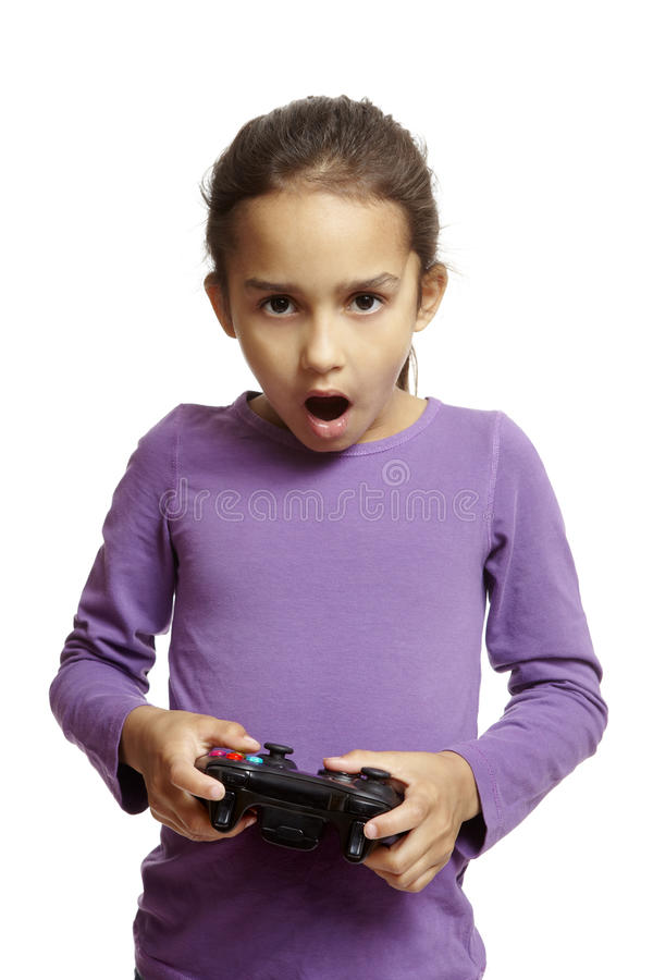 Girl playing games console royalty free stock photo