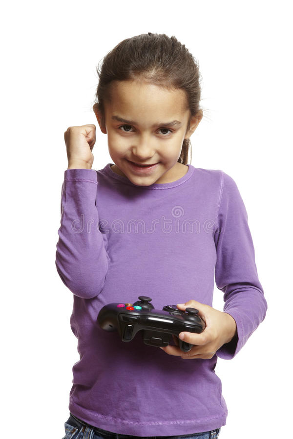 Girl playing games console stock photography