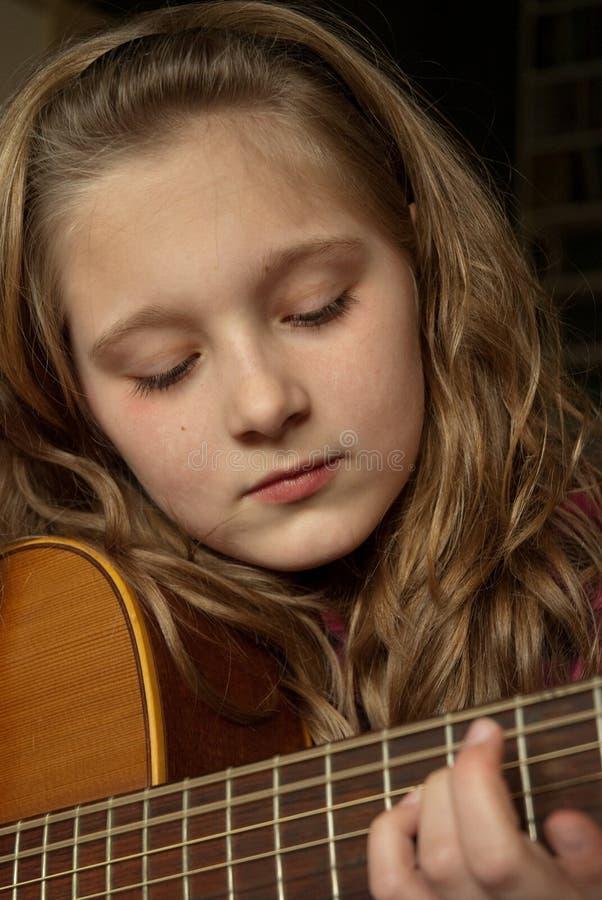 Girl Playing Guitar Royalty Free Stock Image
