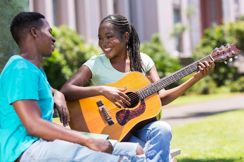 Girl playing guitar boyfriend stock images