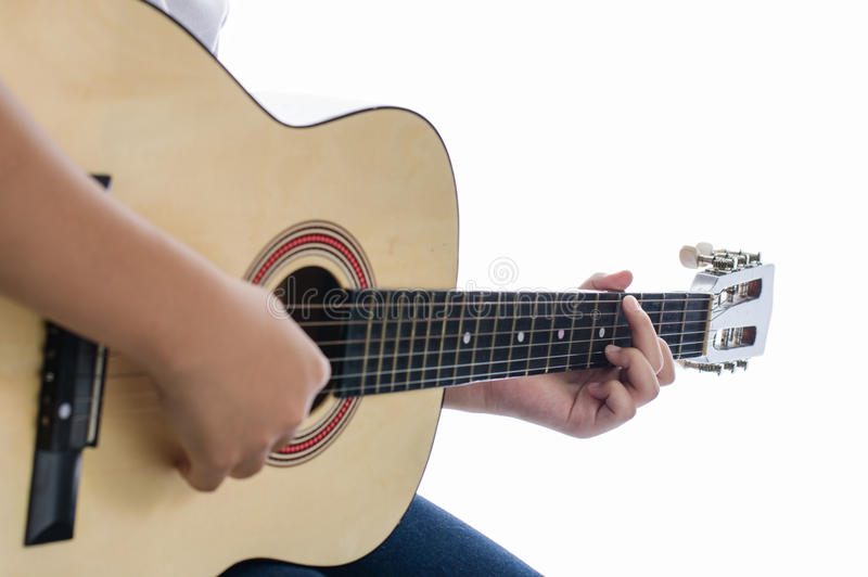 Girl playing guitar - Focus hand. royalty free stock images