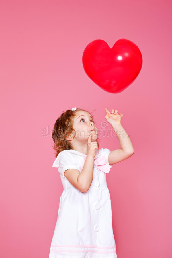Girl Playing With Heart Shaped Balloon Stock Photography