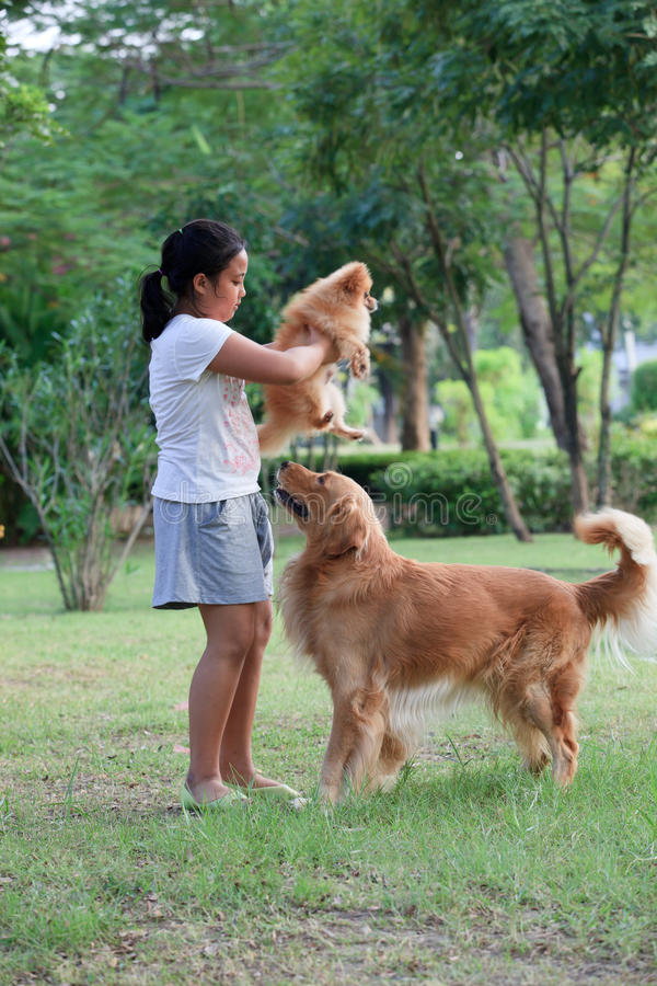 Girl playing with her pet in home garden