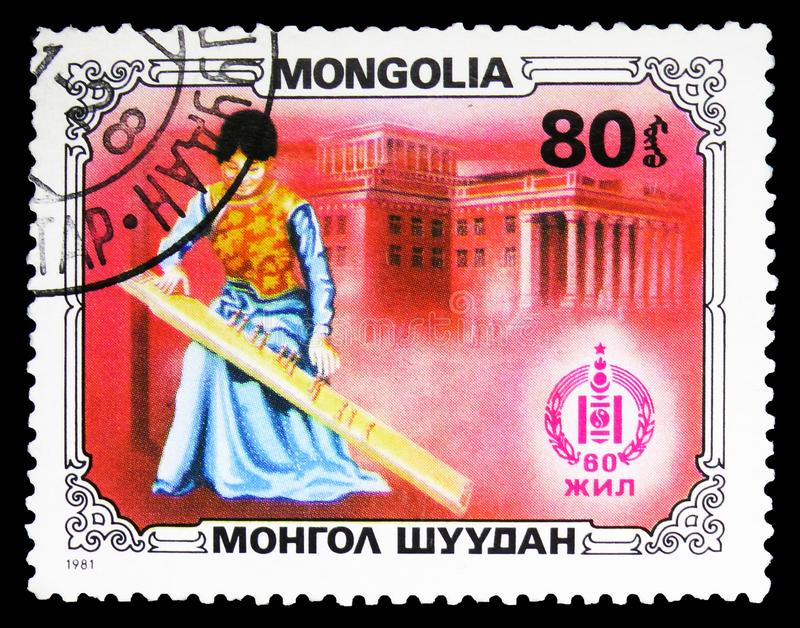 Girl playing jatga, Sport and culture serie, circa 1981. MOSCOW, RUSSIA - SEPTEMBER 26, 2018: A stamp printed in Mongolia shows Girl playing jatga, Sport and royalty free stock photography