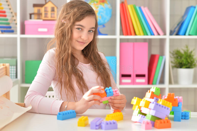 Download Girl playing lego game stock photo. Image of play, small - 88122616