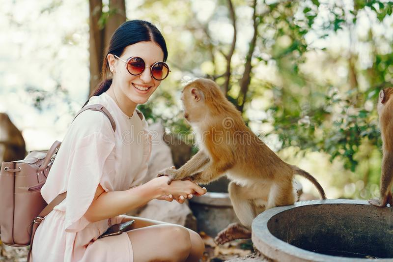 Girl playing with monkey royalty free stock photos