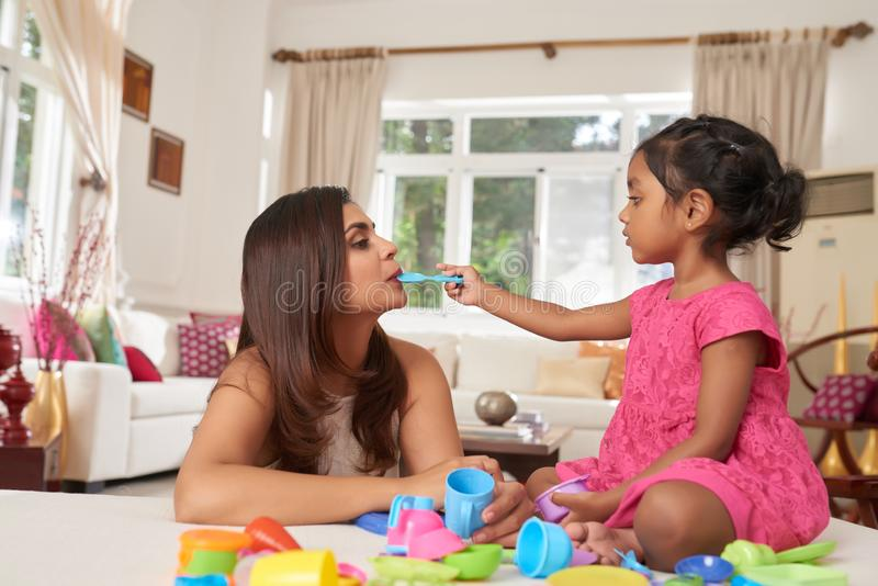 Girl playing with mother royalty free stock photos