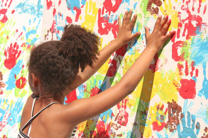 Girl playing with paint stock photography
