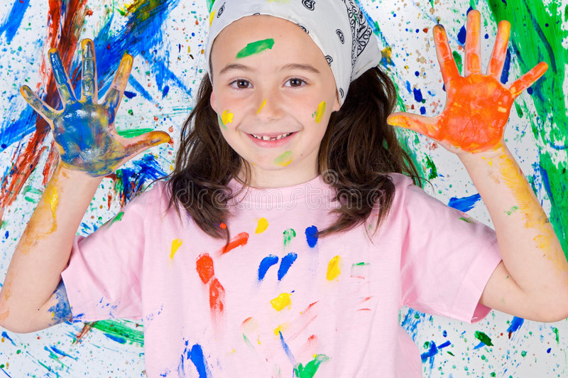 Girl playing with painting stock photos