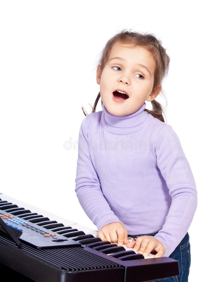 Girl Playing The Piano Stock Photography