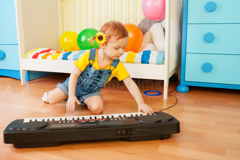 Download Girl playing piano stock image. Image of jeans, nursery - 23782687