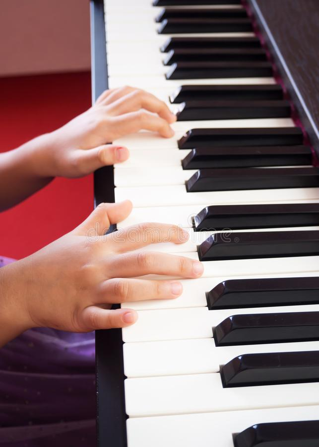 Girl playing piano. Closeup hand and finger. Favorite classic music. royalty free stock photos