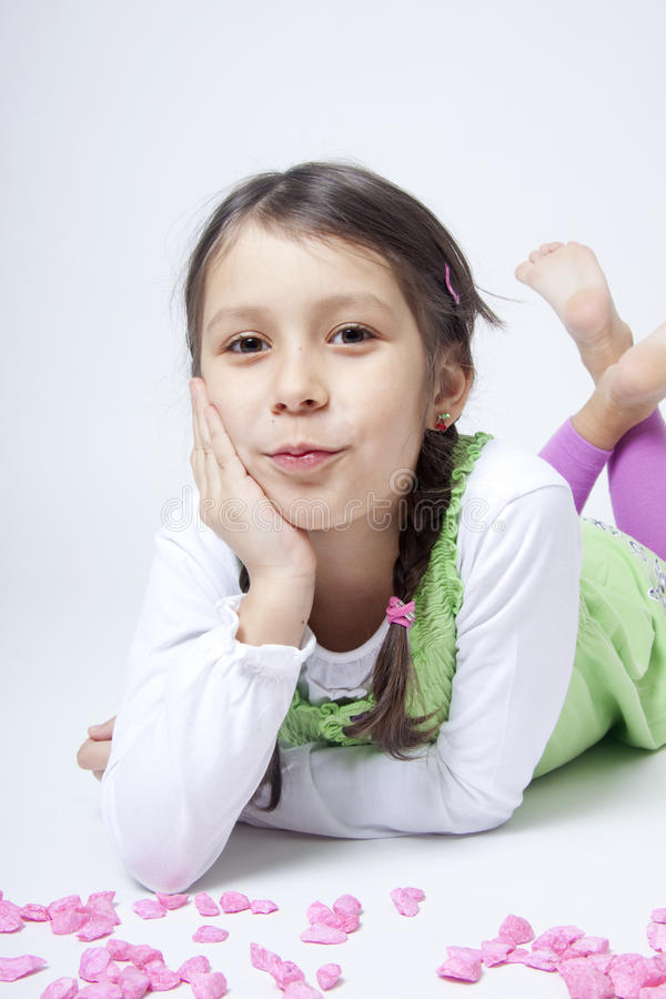 Download Girl Playing With Pink Grit Stock Photo - Image: 18018950
