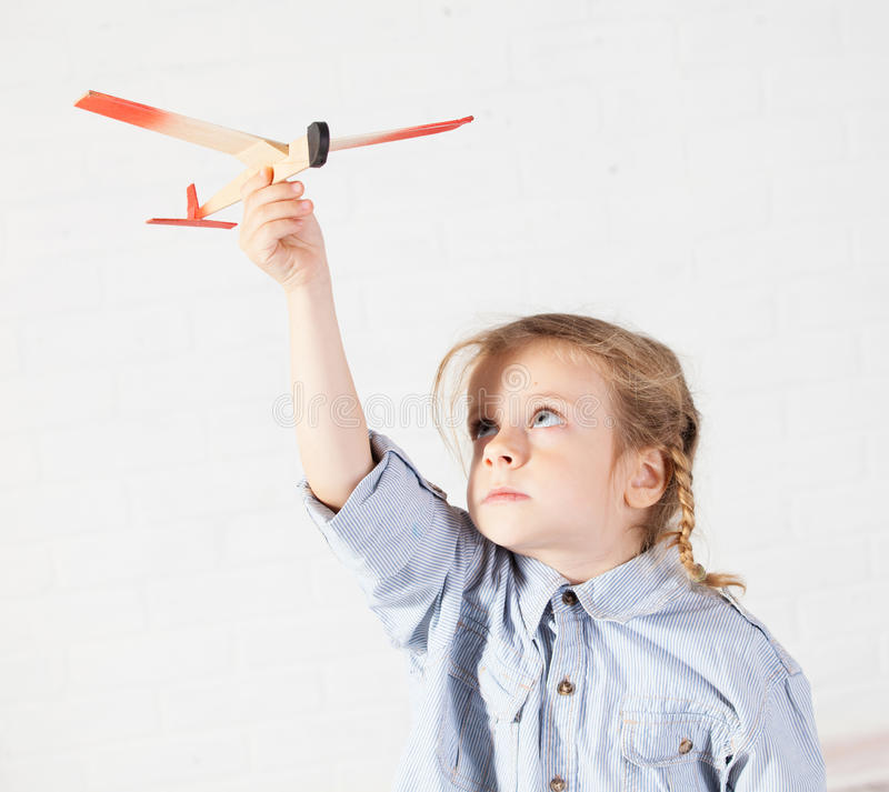 Girl playing with plane royalty free stock photos