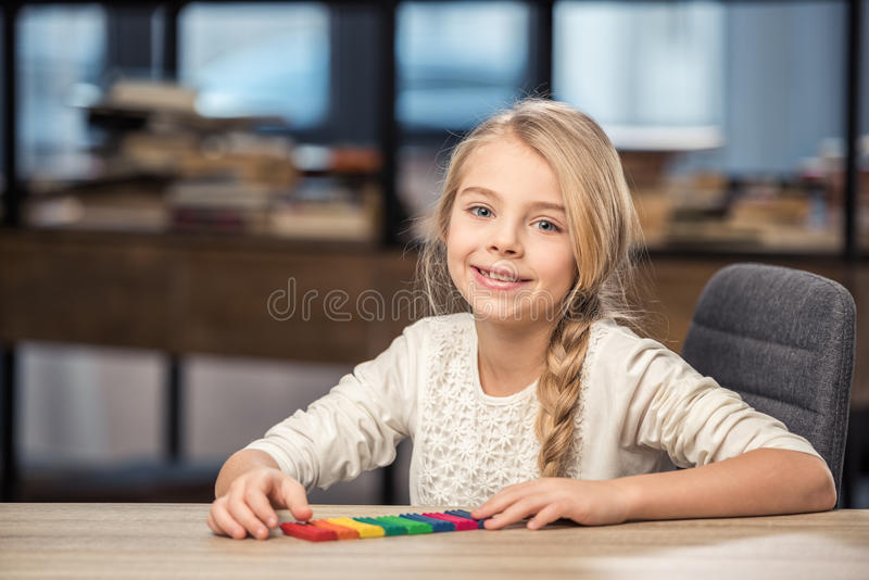 Girl playing with plasticine stock photography