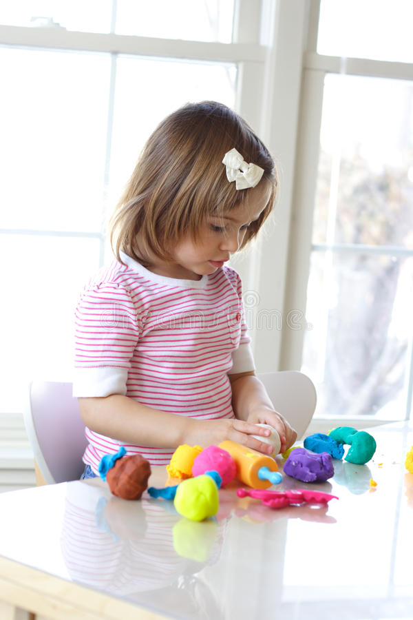 Download Girl Playing With Play Dough Stock Image - Image: 12580949