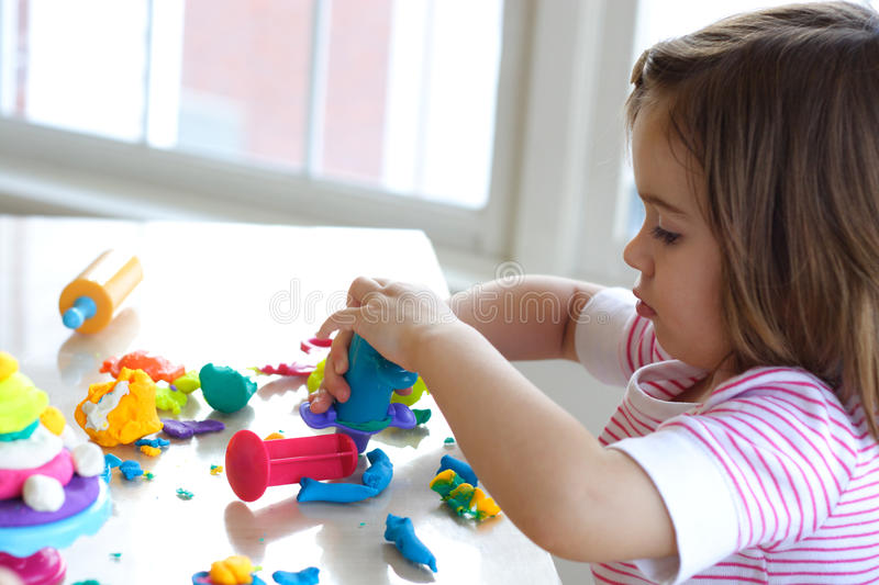 Download Girl Playing With Play Dough Stock Photo - Image of childhood, learn: 12850420