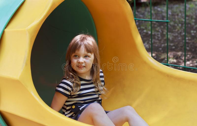 Girl playing on the playground royalty free stock photos