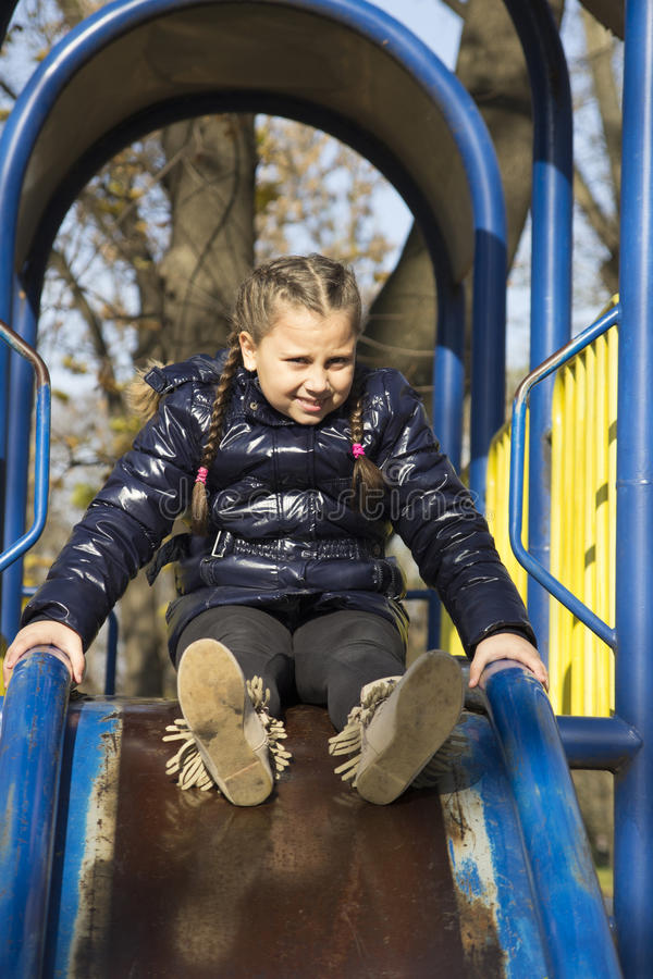 Download The Girl Playing On The Playground Stock Image - Image: 83706677