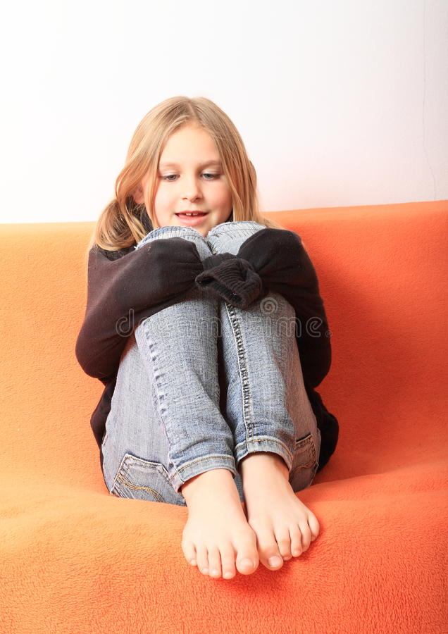 Girl playing with pullover royalty free stock photos