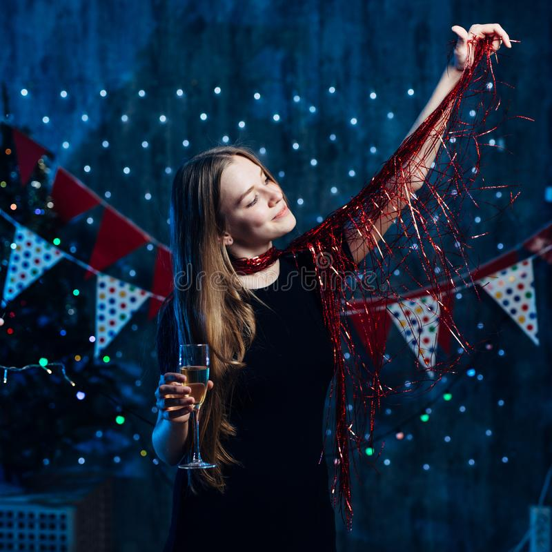 Girl playing with red tinsel Christmas New Year. stock image