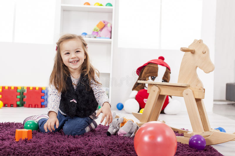 Girl playing in the room stock photo