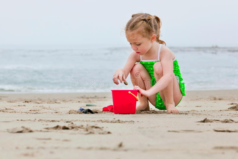 Girl playing in the sand royalty free stock images