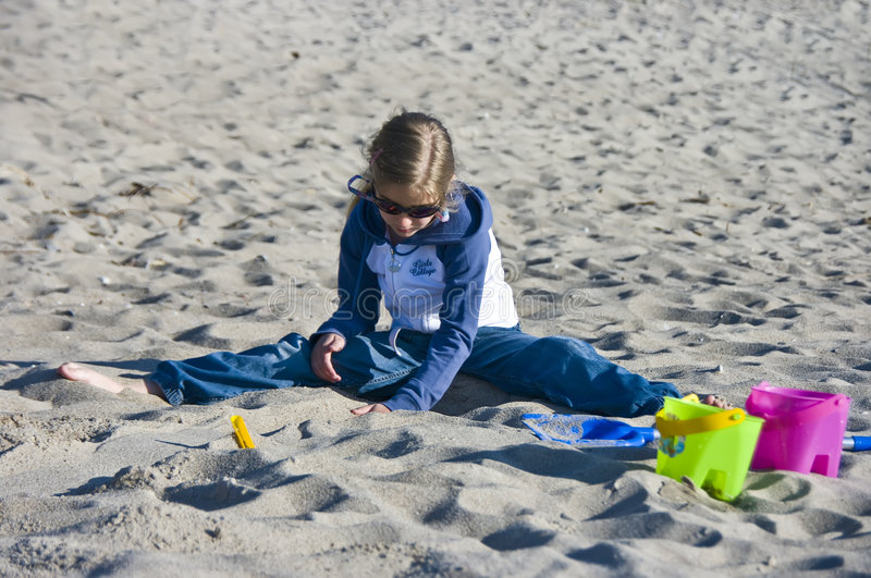 Girl playing in sand royalty free stock image