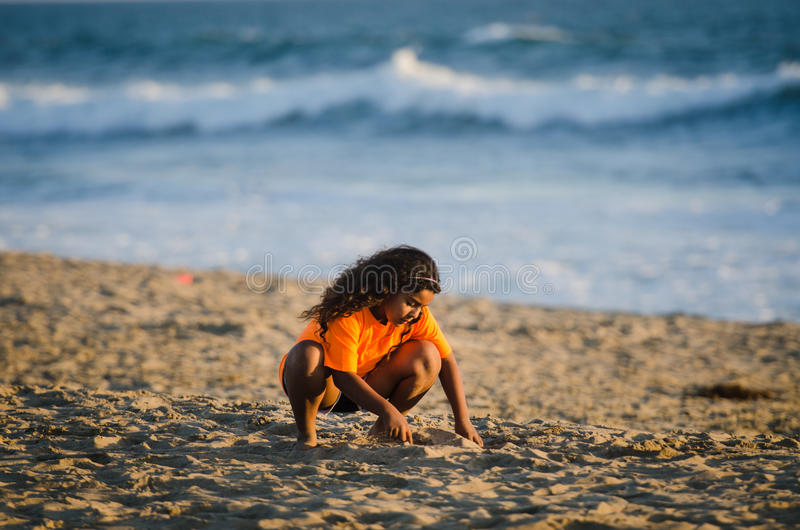 Girl Playing on Sand - Huntington Beach - California royalty free stock images