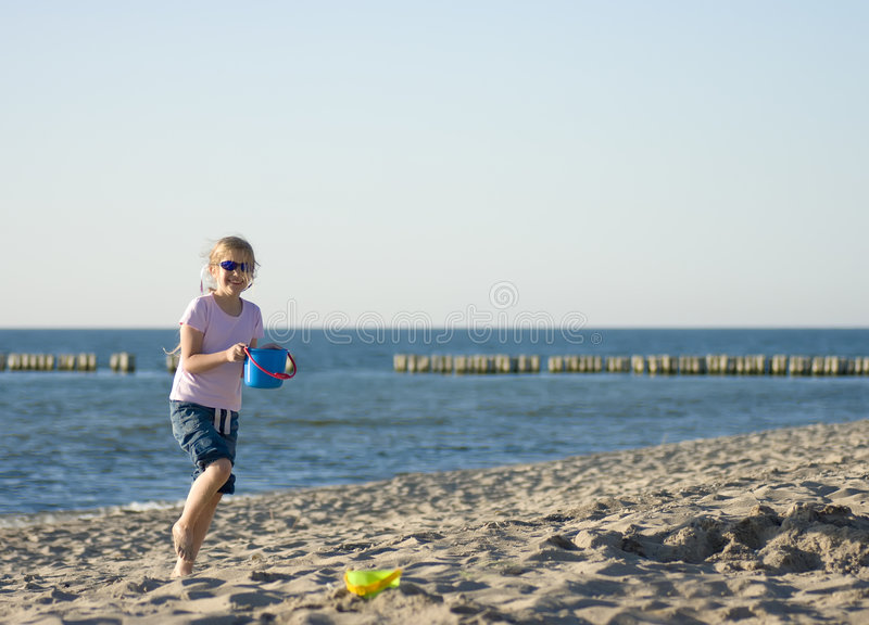 Girl playing on sandy beach royalty free stock image