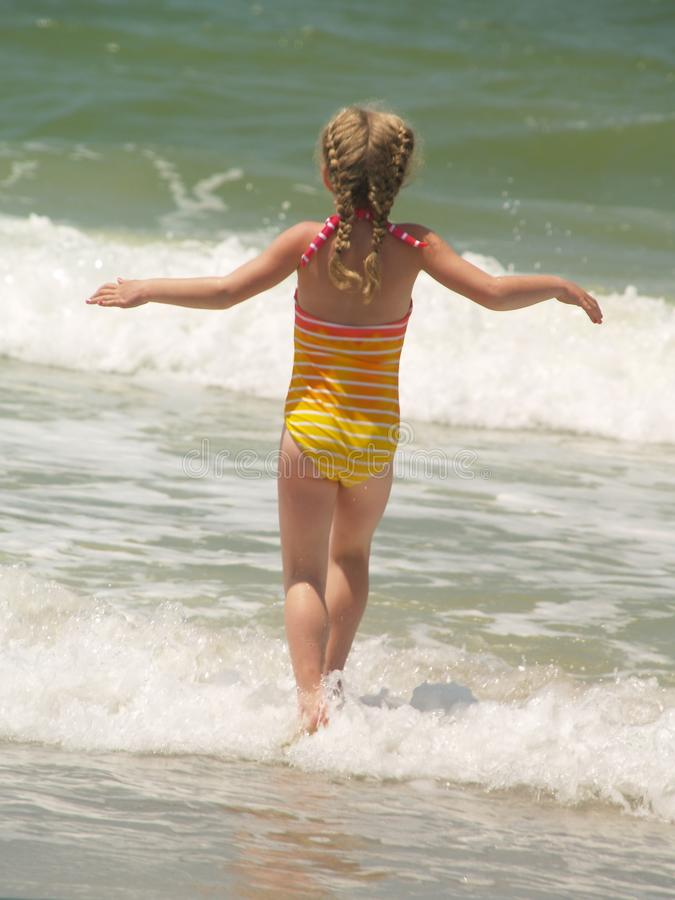 Girl playing in sea royalty free stock photos