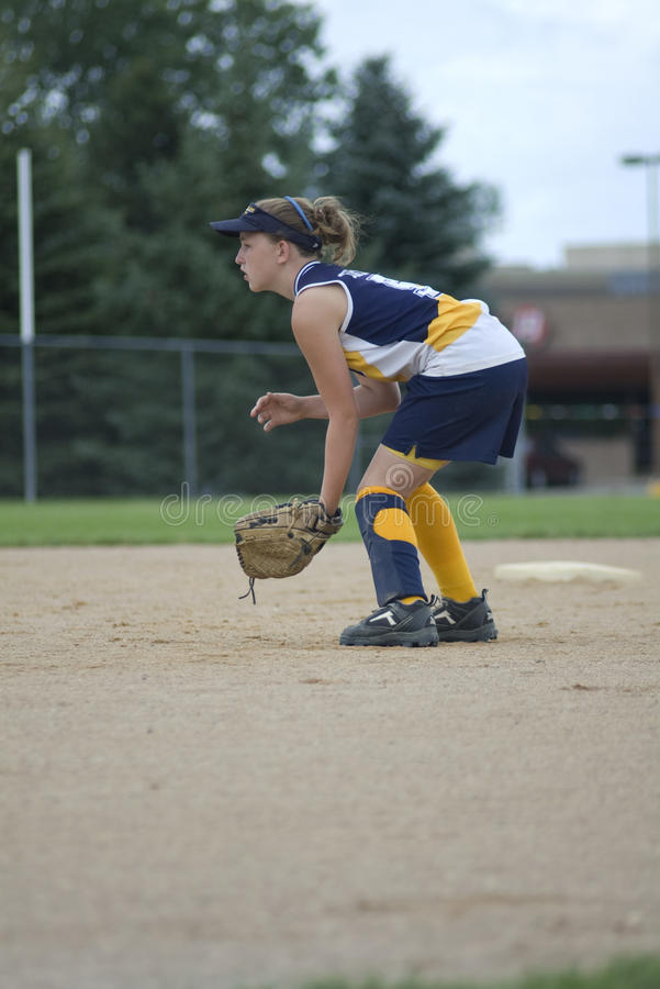 Girl Playing Second Base on Softball Field. Girl in position at second base on softball field stock photography