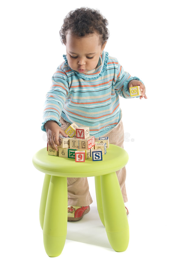 Girl playing with small pieces royalty free stock photo