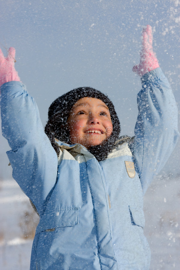 Girl playing with snow royalty free stock photography