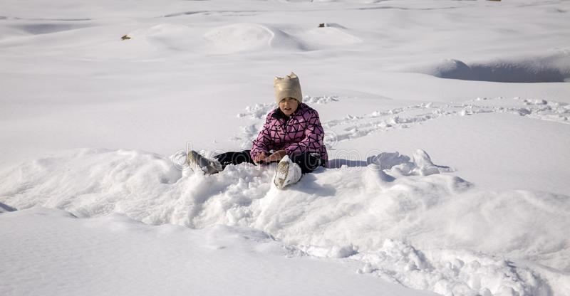 Girl playing in the snow. stock photography