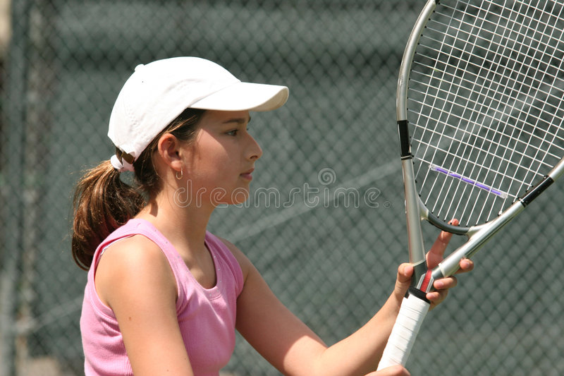 Girl playing tennis stock images