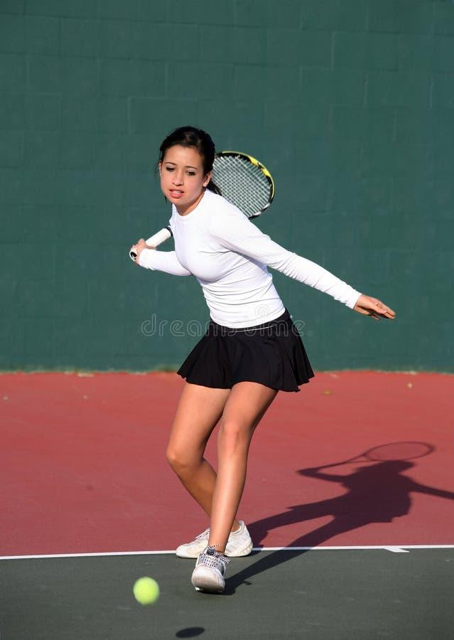 Girl playing tennis stock photos